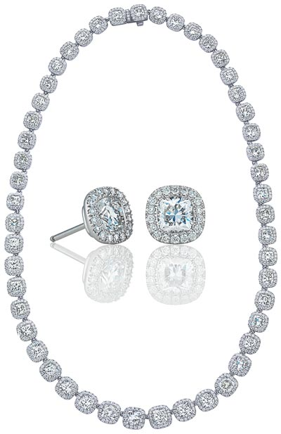 - <b>De Beers Aura</b> graduated cushion cut diamond necklace with matching diamond studs worn by Lily James at the Première of the movie Cinderella