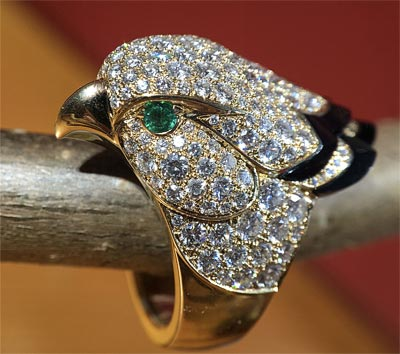 - Falcon ring paved withdiamonds - emeralds and onyx