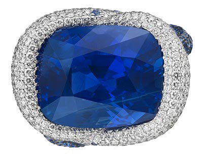 - <b>Ring</b> in18ct white gold featuring a20.9cts cushion-shaped sapphire and set withbrilliant-cut diamonds and brilliant-cut sapphires - <b>Ref.: 820755-1310</b>