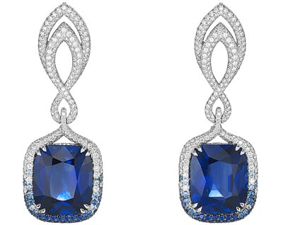 - <b>Earrings</b> in18ct white gold set withcushion-shaped vivid-blue sapphires (31.6cts) and adorned withbrilliant-cut diamonds (3cts) and brilliant-cut sapphires - <b>Ref.: 849864-1002</b>
