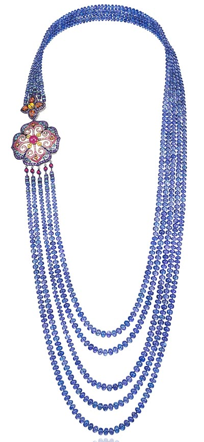 -  <b>Necklace</b> in18ct white gold and titanium set withtanzanite beads (843cts) - mutlicolored sapphires (8.5cts) - amethysts (7.6cts) - rubies (5cts) - Paraiba tourmalines (3.9cts) and tanzanites (1.6ct) - <b>Ref.: 819738-9001</b>