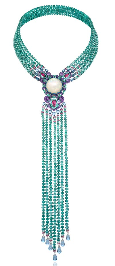 - <b>Necklace</b> in18ct white gold and titanium featuring a29.8cts black opal and set withemerald beads (413cts) - topazs (29cts) - amethysts (5.9cts) - rubies (4.4cts) - Paraiba tourmalines (4cts) - rubelites (3.9cts) - emeralds and sapphires - <b>Ref.: 819735-9001</b>