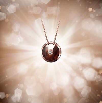 - <b>Amulette de Cartier pendant Small Model - </b> Pink gold, snakewood, adiamond, chain inpink gold