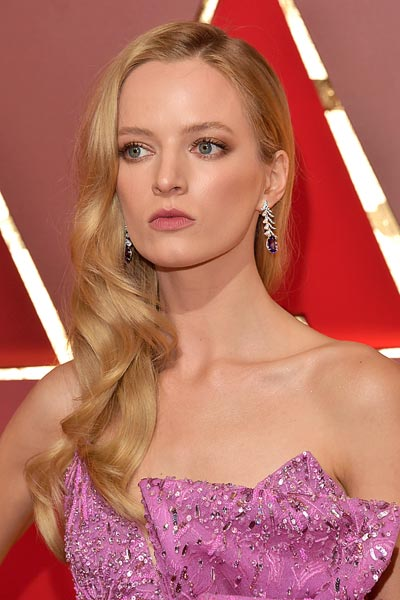 Daria Strokous wears theGlycine high jewelry earrings witha pink Flamingo ring