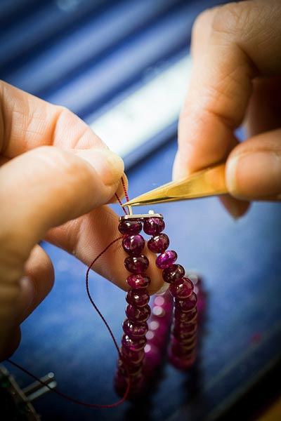 - Threading beads of ruby