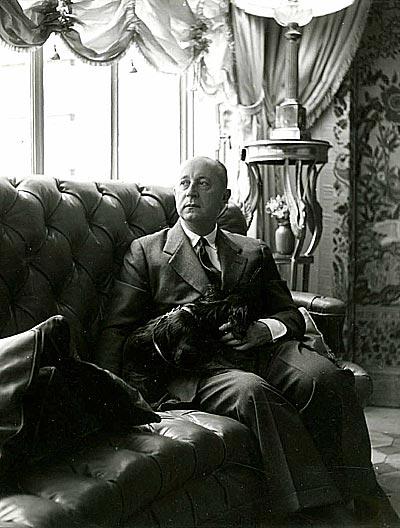 - Christian Dior  inhis apartment at7 Boulevard Jules-Sandeau inParis, circa 1950.<br>© Christian Dior.