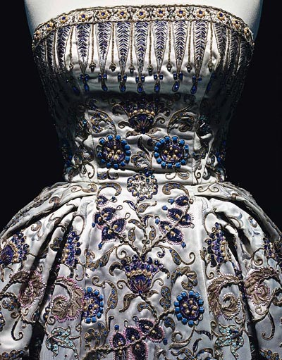 - Christian Dior, Palmyre gown, Fall-Winter 1952 Haute Couture collection, Profilée line, evening gown in satin by Robert Perrier, embroidered with Swarovski crystals, metallic thread, gemstones, pearls and sequins by Ginesty, Paris, Dior Héritage.<br>© Photo Les Arts Décoratifs, Paris / Nicholas Alan Cope.