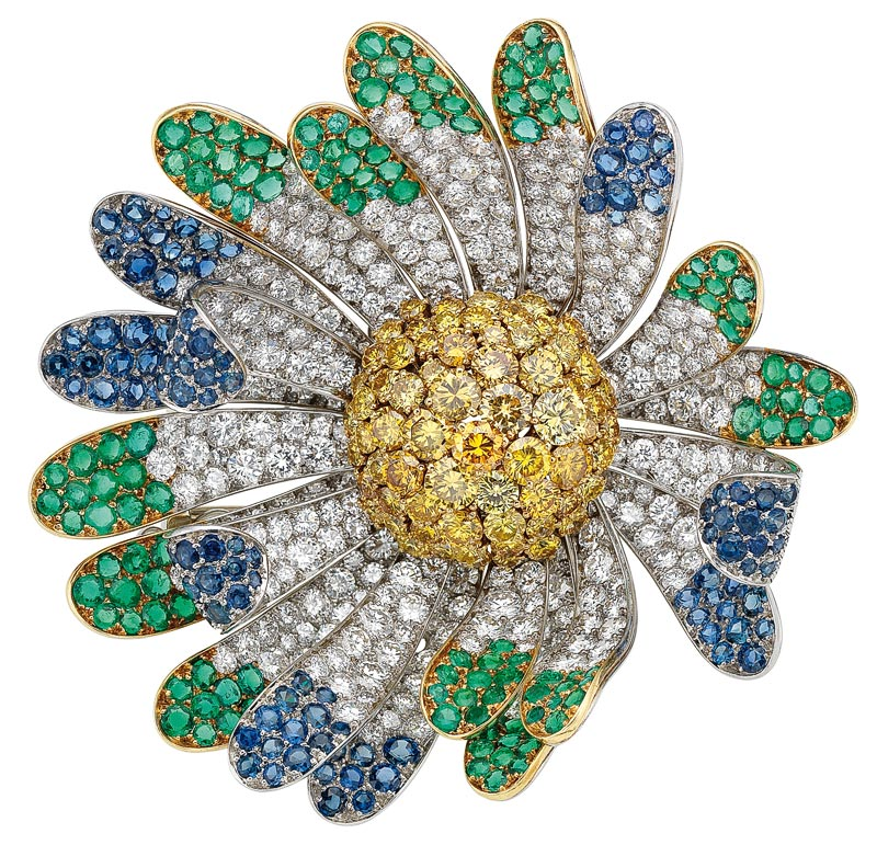 - <b>Bvlgari Heritage Collection:</b> <br>Flower brooch in platinum with emeralds, sapphires, fancy yellow diamonds and diamonds, 1969 <br>Ref.: MUS0400
