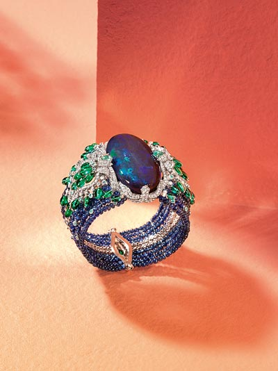 Lagon bracelet: Platinum, one 85.42-carat oval-shaped cabochon-cut black opal, sapphire beads, emerald long beads, Paraiba tourmalines, brilliant-cut diamonds.