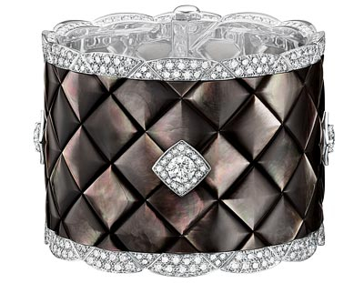 """""""Signature de Nacre"""" cuff  in18K white gold set with496 brilliant-cut diamonds for atotal weight of20.3 carats and carved mother-of-pearl. """"Signature de  Chanel"""" Collection"""