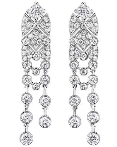 """Signature White Tie"" earrings in 18K white gold set with 2 cushion-cut diamonds for a total weight of 1 carat and 116 brilliant-cut diamonds for a total weight of 3.3 carats.  ""Signature de  Chanel"" Collection"