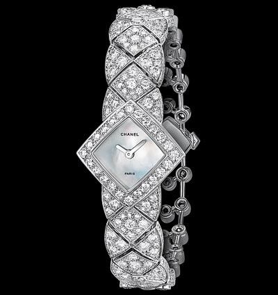 """Signature White Tie"" watch in 18K white gold set with 301 brilliant-cut diamonds for a total weight of 7.7 carats and carved mother-of-pearl, quartz movement. ""Signature de  Chanel"" Collection"