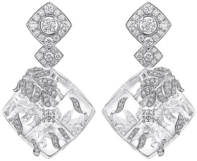 """Signature Cocoon"" earrings in 18K white gold set with 251 brilliant-cut diamonds for a total weight of 3 carats and carved rock crystal. ""Signature de  Chanel"" Collection"
