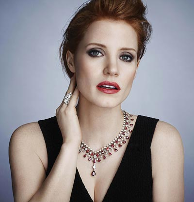 Picture ofJessica Chastain – Photographer: James White – Stylist: Elizabeth Stewart –Alaia dress – Hair stylist: Renato – Make-up artist: Mary Greenwell Necklace inplatinum set with1 pear-shaped ruby (approx. 4.41 cts), 45 pear-shaped rubies (approx. 48.90 cts), 1 princess-cut diamond (approx. 1.77 cts) and 158 brilliant-cut diamonds (approx. 23.89 cts). Ref.: G37M5100 Ring in18K white gold set with1 marquise-cut diamond (approx. 1.01 cts), 14 marquise-cut diamonds (approx. 2.33 cts) and 55 brilliant-cut diamonds (approx. 1.42 cts). Ref.: G34HD400