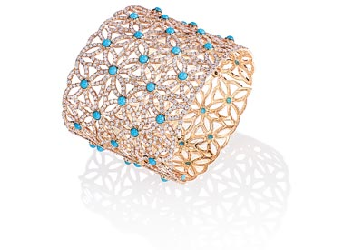 Extremely Piaget cuff bracelet «Décor Dentelle» in18K pink gold set with50 turquoise cabochons (approx. 16.50 cts) and 1 602 brilliant-cut diamonds (approx. 20.87 cts). Ref.:G36LA500